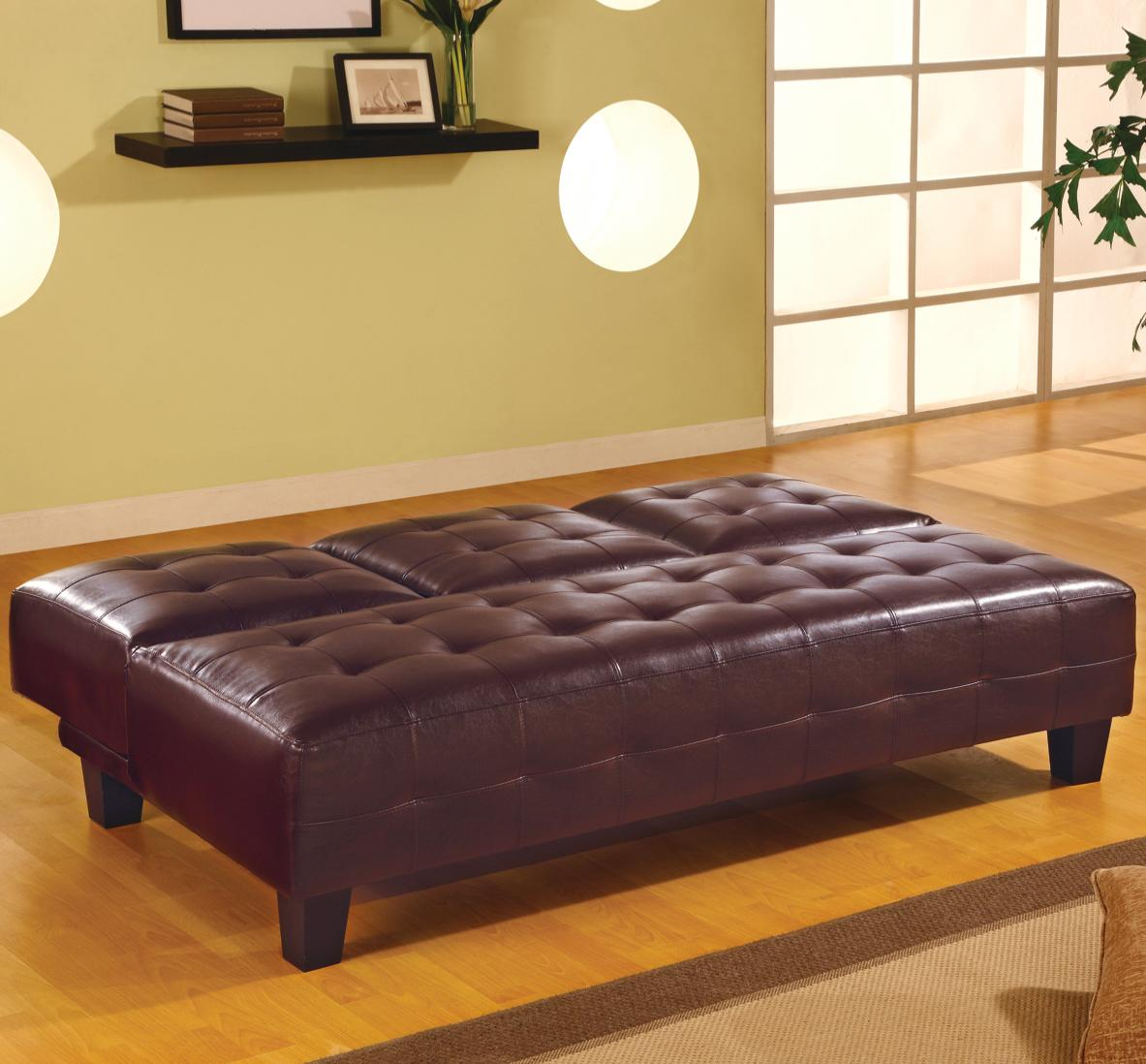 Brown Armless Convertible Sofa Bed with Drop Down Console in down position
